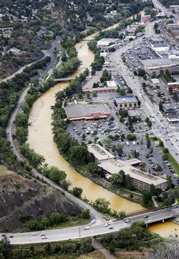 A toxic sludge flows down the Animas River through Durango Colo, on Friday, Aug. 7, 2015, after the Gold King Mine north of Silverton Colo., spilled heavy minerals into the river on Wednesday. Federal environmental officials say it's too early to know whether heavy metals that spilled into a river from a Colorado mine pose a health risk.  (Jerry McBride(/The Durango Herald via AP)