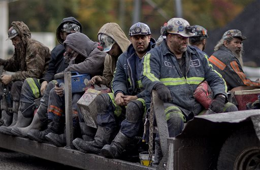 ADVANCE FOR USE SUNDAY, SEPT. 6, 2015 AND THEREAFTER - FILE - In this Oct. 15, 2014 photo, coal miners return on a buggy after working a shift underground at the Perkins Branch Coal Mine in Cumberland, Ky. As recently as the late 1970s, there were more than 350 mines operating at any given time in Harlan County. In 2014, it's around 40. (AP Photo/David Goldman, File)