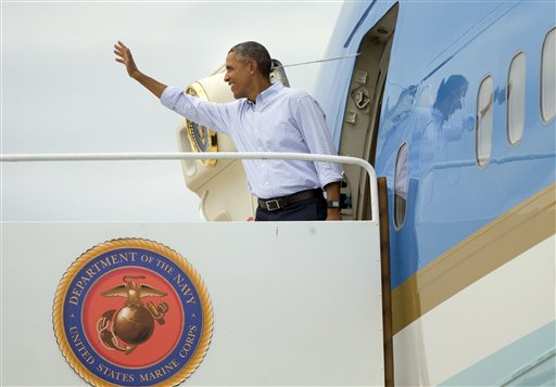 President Barack Obama waves as he boards Air Force One prior to his departure from Marine Corps Air Station Miramar, Calif., Monday, Oct. 12, 2015. Obama is returning to Washington after wrapping up a 4-day west coast swing. (AP Photo/Pablo Martinez Monsivais)