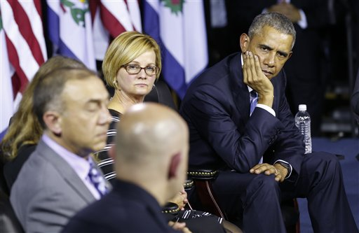 President Barack Obama, right, listens to Charleston Police Chief, Brent Webster, front along with Dr. Michael Brumage, left, Cary Dixon, second from left, during an event at the East End Family Resource Center in Charleston, W.Va., Wednesday, Oct. 21, 2015. Obama is in Charleston to to host a community discussion on the prescription drug abuse and heroin epidemic. (AP Photo/Steve Helber)