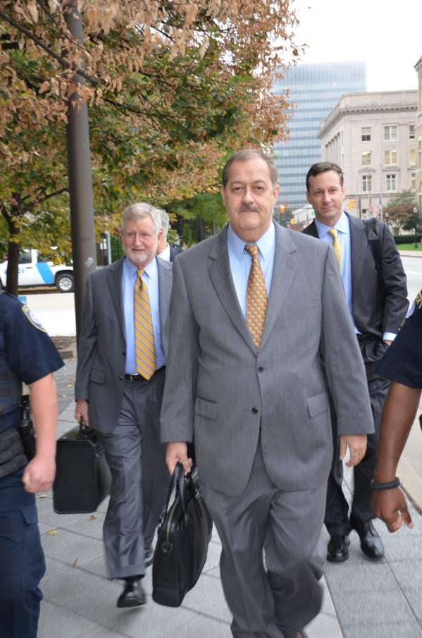 Former Massey Energy CEO Don Blankenship and his lawyers enter the Robert C. Byrd U.S. Courthouse on Tuesday morning. Photo by Joel Ebert.