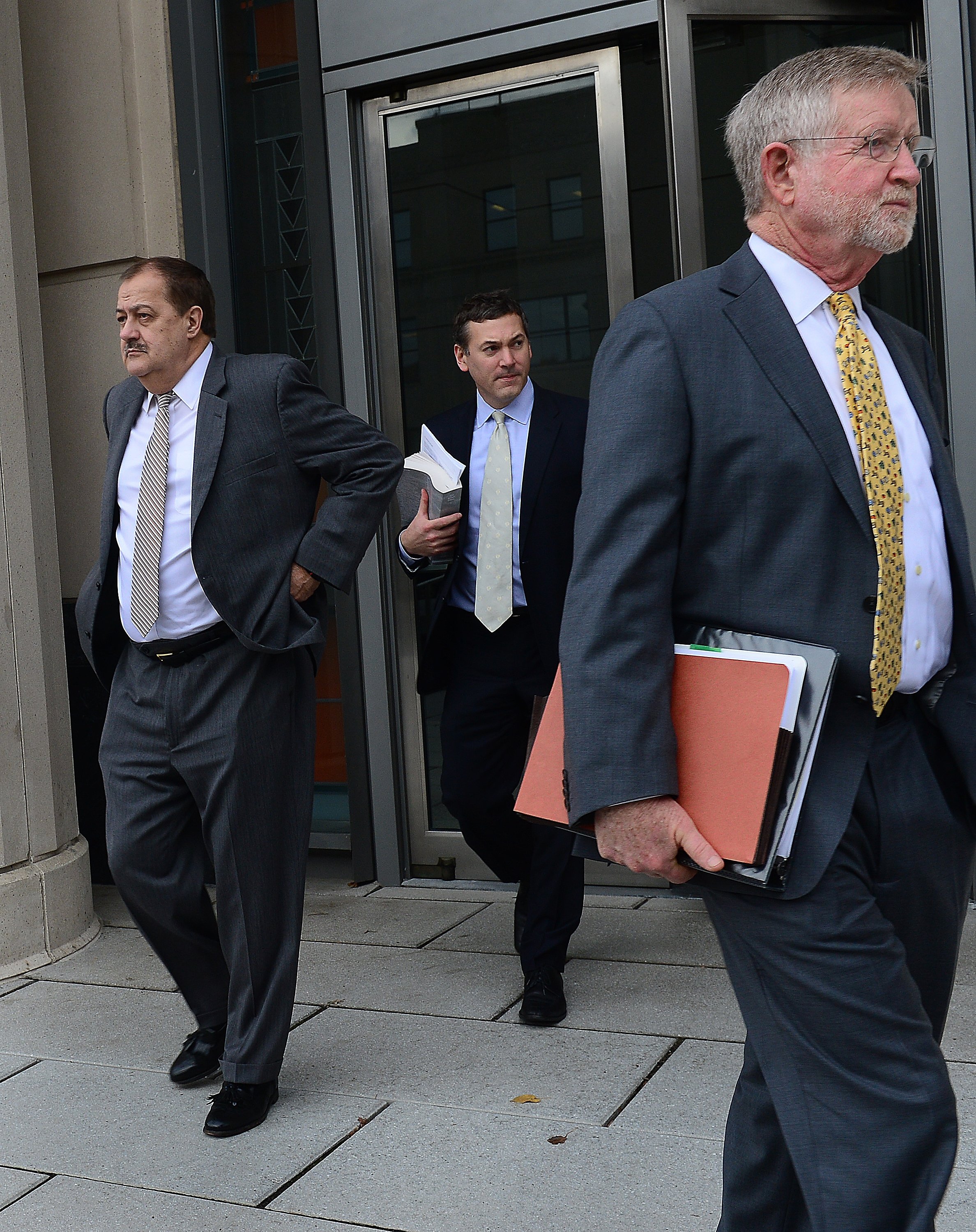F. BRIAN FERGUSON | Gazette-Mail Don Blankenship, left, and his legal team leave federal court on Wednesday after a juror fell ill.