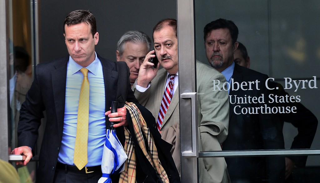 F. BRIAN FERGUSON | Gazette-Mail Don Blankenship, center, and his legal team exit the Robert C. Byrd Courthouse during Tuesday's lunch break.