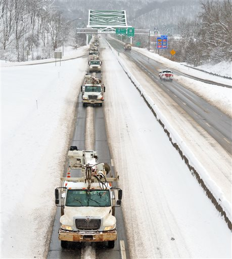 Utility trucks head west bound on I64 crossing the St. Albans/Nitro bridge, in St. Albans, W.V., Saturday, Jan. 23, 2016. (Tom Hindman /Charleston Gazette-Mail via AP) MANDATORY CREDIT