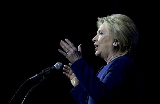 Democratic presidential candidate Hillary Clinton and Democratic speaks at the Ohio Democratic Party Legacy Dinner at the Greater Columbus Convention Center in Columbus, Ohio, Sunday, March 13, 2016. (AP Photo/Carolyn Kaster)