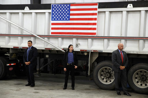 Secret Service agents stand post as Republican presidential candidate Donald Trump speaks during a coal mining roundtable at Fitzgerald Peterbilt, Wednesday, Aug. 10, 2016, in Glade Spring, Va. (AP Photo/Evan Vucci)