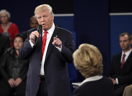 Republican presidential nominee Donald Trump points at Democratic presidential nominee Hillary Clinton as he speaks during the second presidential debate at Washington University in St. Louis, Sunday, Oct. 9, 2016. (Saul Loeb/Pool via AP)