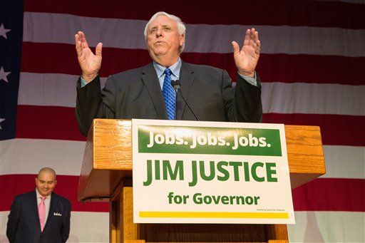 West Virginia Governor-elect Jim Justice speaks to supporters at the Greenbrier Resort in White Sulphur Springs, W. Va., after winning the 2016 West Virginia governor's race on Tuesday, Nov. 8, 2016. (AP Photo/Walter Scriptunas II)