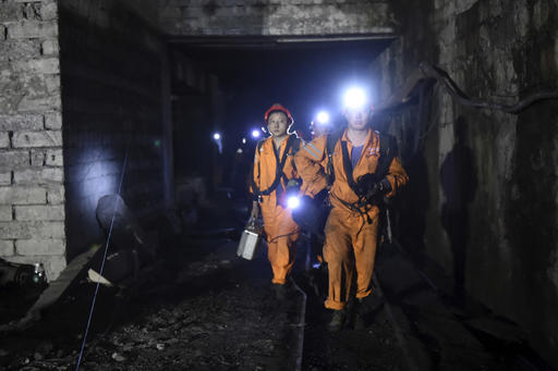 In this Monday, Oct. 31, 2016 photo released by China's Xinhua News Agency, rescuers work at Jinshangou Coal Mine in Chongqing, southwest China. Rescuers worked through the night at the privately owned Jinshangou mine where the explosion occurred before noon Monday, Xinhua News Agency reported. (Tang Yi/Xinhua via AP)
