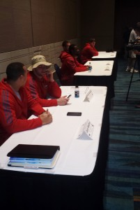 The NIU contingent waits to take questions.