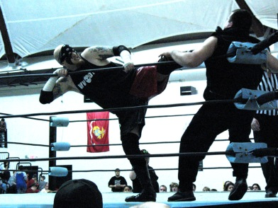 Juggs puts the boot to Guido in the ring.