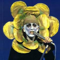 "Peter Gabriel, fronting Genesis and taking the whole 'flower child"" thing to a new level"