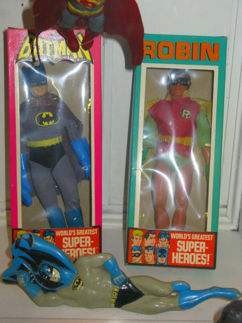MEGO Batman and Robin in the box, with an extra Batman lounging in front