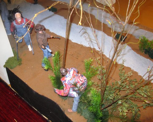 We rejoin the diorama looking down at Carl and Hershel.