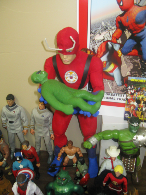 Giant Man cradling a leetle monster
