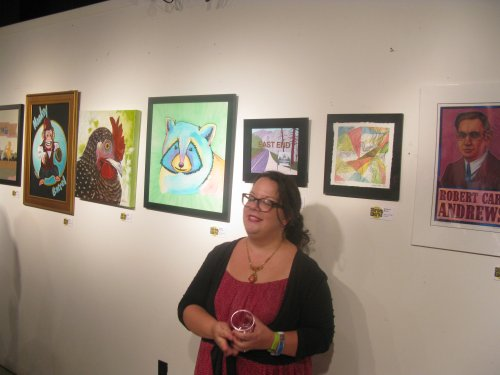 Stealing a photo of Rebecca Recco as she poses for someone else in front of her art