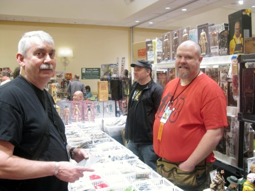 Legendary collector (and co-moderator of The Trenches with his wife Charlotte) spending money at Cotswold Collectibles booth with Greg Brown
