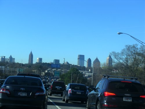Traffic, with the Atlanta skyline