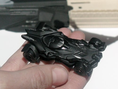 The exclusive battle-damanged Batmobile from Batman vs. Superman