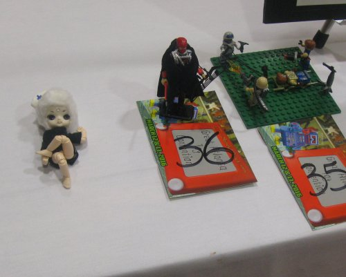 On the far right, 3rd place Youth diorama winner, Nicki Kossin - Kreo Zombie Slayer