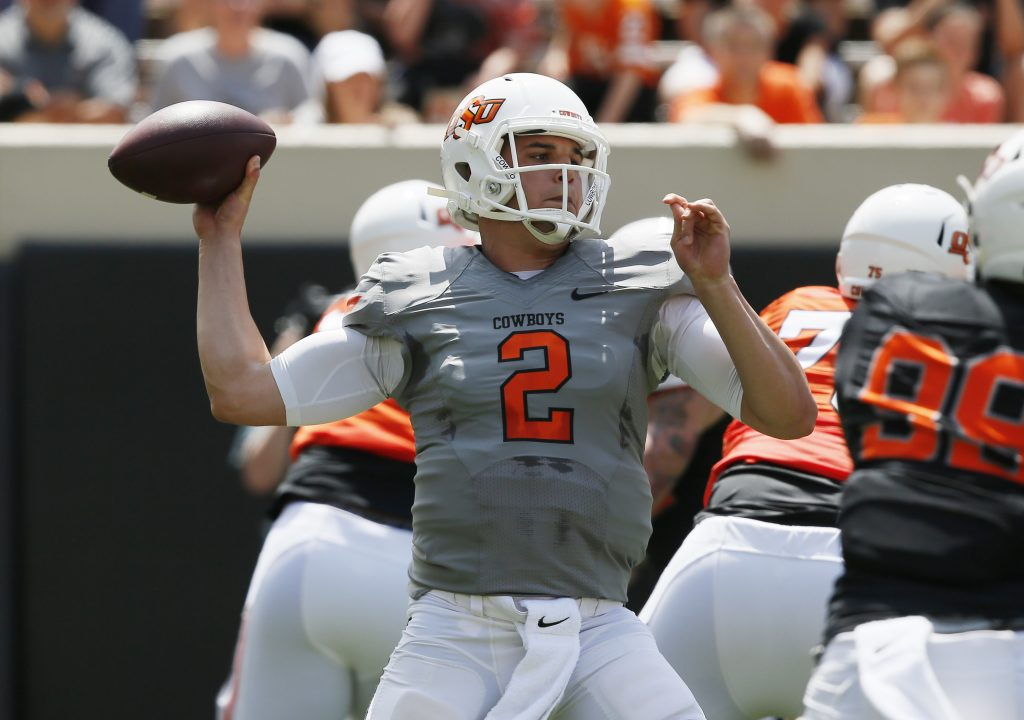 In this Saturday, April 15, 2017 file photo, Oklahoma State quarterback Mason Rudolph throws during an intra squad spring NCAA college football game in Stillwater, Okla. Oklahoma State believes Rudolph has a shot at the Heisman Trophy. (AP Photo/Sue Ogrocki)