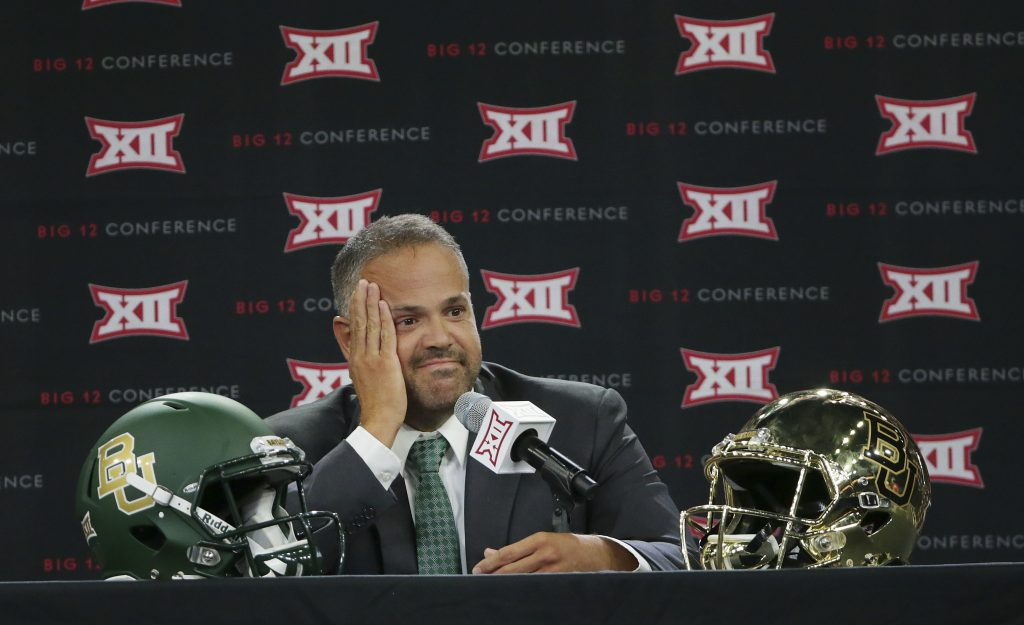 Baylor head football coach Matt Rhule listens to a reporter's question during the Big 12 NCAA college football media day in Frisco, Texas, Tuesday, July 18, 2017. (AP Photo/LM Otero)