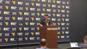West Virginia football head coach Dana Holgorsen addresses the media Wednesday. Photo by Ryan Decker