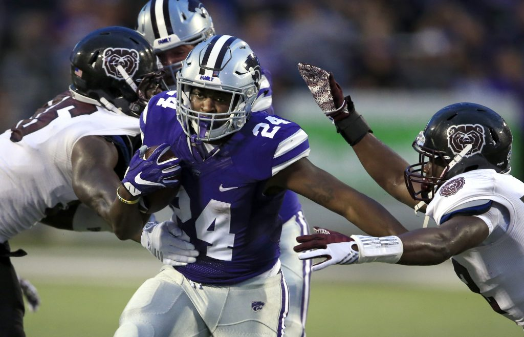 Kansas State running back Charles Jones (24) splits Missouri State defenders Tony Jones, left, and Anthony Upchurch, right, during the first half of an NCAA college football game in Manhattan, Kan., Saturday, Sept. 24, 2016. (AP Photo/Orlin Wagner)
