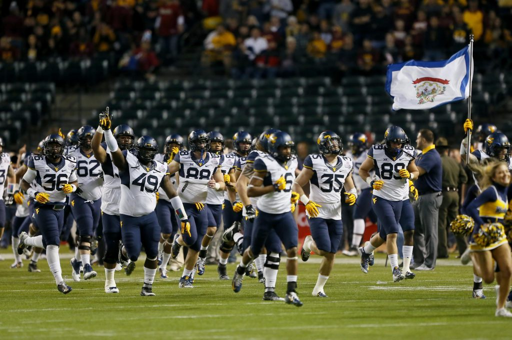 West Virginia takes the field prior to the Cactus Bowl NCAA college football game against Arizona State, Saturday, Jan. 2, 2016, in Phoenix. (AP Photo/Matt York)