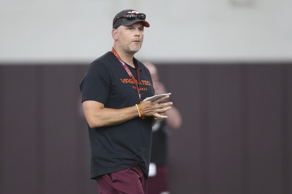 Virginia Tech coach Justin Fuente looks over his team at the start of NCAA college football practice in Blacksburg, Va., Thursday Aug. 3, 2017. | AP photo