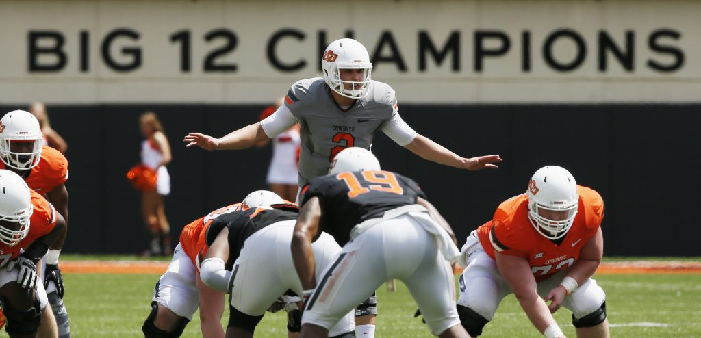 FILE - In this April 15, 2017 file photo, Oklahoma State quarterback Mason Rudolph (2) prepares for the snap during an intra squad spring NCAA college football game in Stillwater, Okla. Rudolph is statistically one of the best quarterbacks in school history, and the school is pushing him as a Heisman candidate. (AP Photo/Sue Ogrocki, File)