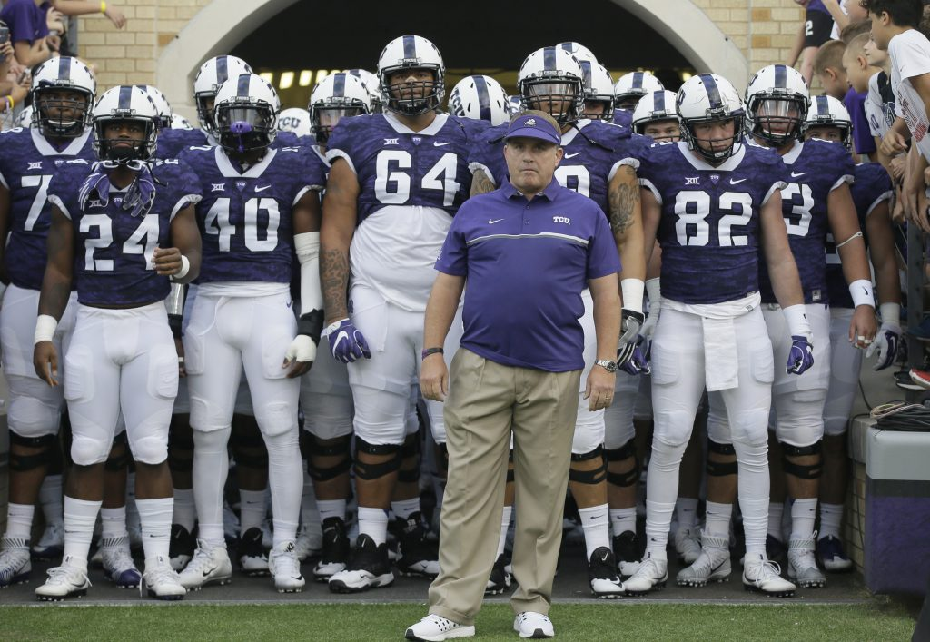 In this Sept. 3, 2016, filephoto, TCU head coach Gary Patterson waits to lead his team onto the field before an NCAA college football game against South Dakota State in Fort Worth, Texas. (AP Photo/LM Otero, File)