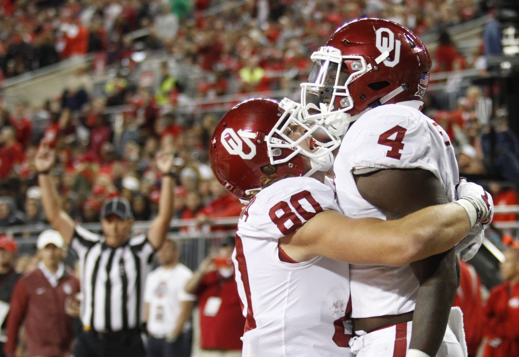 Oklahoma running back Trey Sermon, right, celebrates his touchdown against Ohio State with teammate Grant Calcaterra during the second half of an NCAA college football game, Saturday, Sept. 9, 2017, in Columbus, Ohio. Oklahoma defeated Ohio State 31-16. (AP Photo/Paul Vernon)